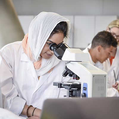 female researcher with microscope